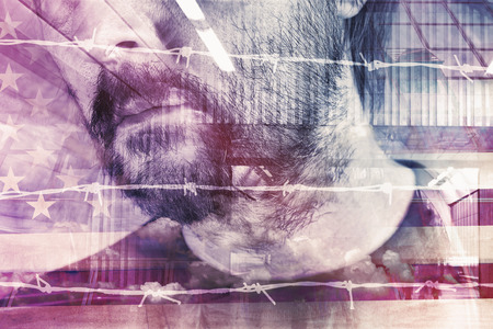 confined: Conceptual double exposure portrait of adult male American behind barbed wire