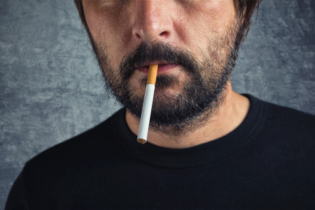 fag: Casual adult man with cigarette in mouth Stock Photo