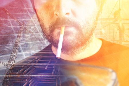 constrution: Double exposure portrait of male constrution worker with cigarette on a work break. Stock Photo