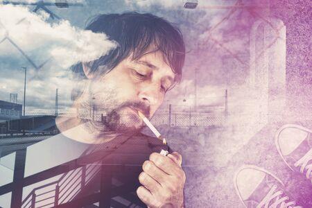 break from work: Double exposure portrait of casual adult man lighting up cigarette on a work break.