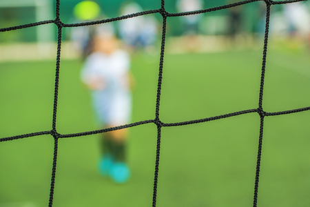 football play: Kids playing soccer, defocussed blur sport background