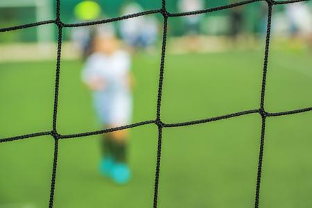 defocussed: Kids playing soccer, defocussed blur sport background