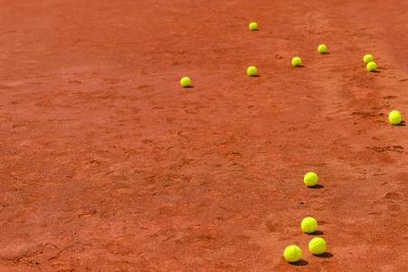 tennis clay: Tennis balls on clay court with copy space as sports background, selective focus