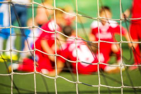 defocussed: Kids soccer team celebrate goal and victory, defocussed blur sport background image Stock Photo