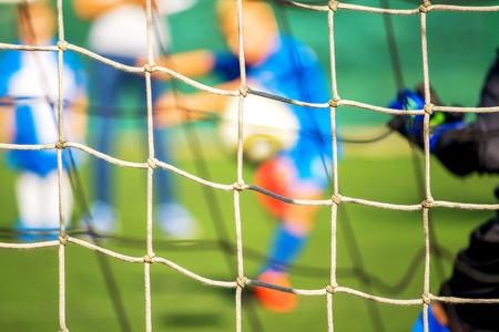 defocussed: Kids playing soccer, penalty kick, defocussed blur sport background image