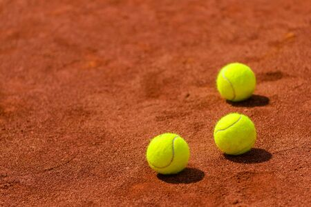 sports balls: Tennis balls on clay court with copy space as sports background, selective focus