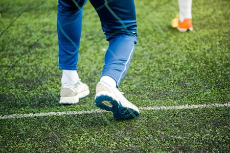 soccer coach: Kids soccer coach on football pitch training kids in sports tactics