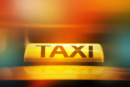 taxi sign: Yellow Taxi Sign on Car Rooftop, Street Light Bokeh, Selective Focus