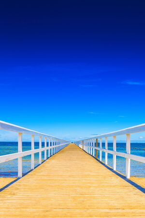 beach holiday: Wooden ocean dock in summer vacation resort Stock Photo