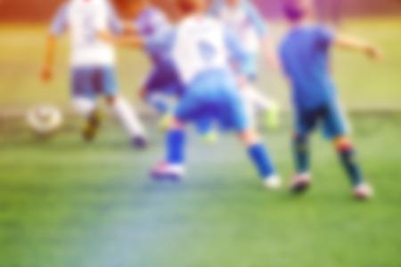 defocussed: Kids playing soccer, defocussed blur sport background image