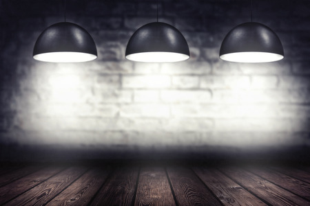 Room with three spotlight lamps, empty 3d space with woodem flooring and brick wall as background or backdrop for product placement Banque d'images