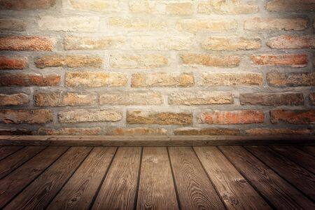 spotlight: Room with spotlight, empty 3d space with woodem flooring and brick wall as background or backdrop for product placement Stock Photo