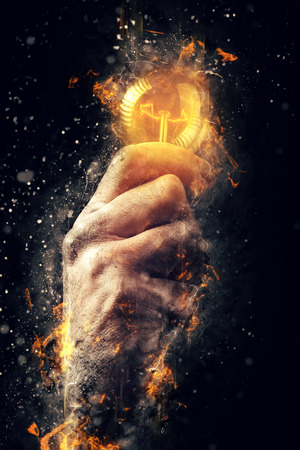 ideas: Power of creative energy and new ideas and understandings, hand with light bulb as metaphor of innovation and creativity, retro toned image, selective focus.
