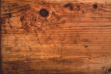 Retro toned rustic oak wood plank texture, used stained wooden board. Stock Photo