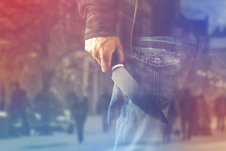 evil: Evil terrorist man with shiny knife, a killer person with sharp knife about to commit an act of violence or terrorism, homicide, murder scenery, double Exposure Stock Photo
