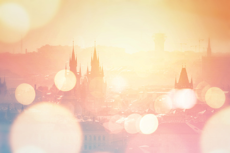distinctive: Beautiful panoramic view of Prague cityscape with distinctive city architectural landmarks on misty summer morning, vintage retro tone effect with bokeh light