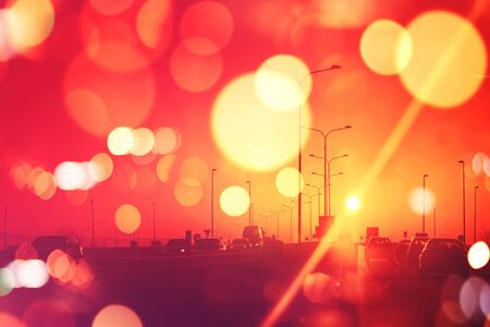 urban road: City traffic in sunset, cars on Roadway,retro toned image with bokeh light