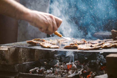 meat grill: Grilling pork meat chops on barbecue, selective focus with shallow depth of field.