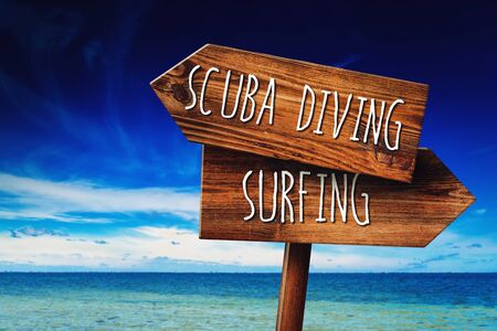 wood sign: Scuba Diving or Surfing Activity, Rustic Wooden Direction Sign in Coastal Summer Vacation Resort
