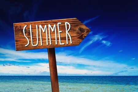 layoff: Summer, Rustic Wooden Direction Sign in Coastal Summer Vacation Resort