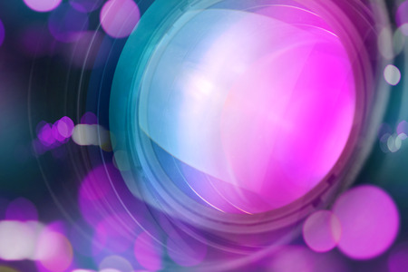 photographic effects: Photographic camera lens front glass with bokeh light, macro shot