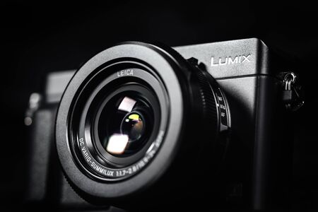 compact camera: NOVI SAD, SERBIA - DECEMBER 1, 2015: Lumix DMC LX100, prosumer compact camera announced by Panasonic on September 15, 2014 with Leica-branded lens, can record 4K video. Illustrative editorial content, selective focus. Editorial