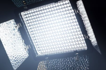 productions: LED lighting equipment for photo and video production in dark studio interior
