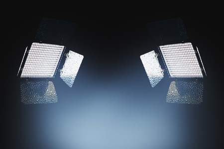 Professional LED lighting equipment for photo and video production in dark studio interior Stock Photo