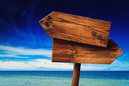 resort beach: Direction Signpost on Coastal Seaside Beach, Rustic Wooden Blank Sign in Tropical Summer Vacation Resort