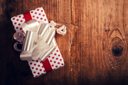 giftware: Gift box on wooden desk with copy space, top view, selective focus Stock Photo
