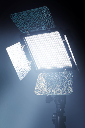 interior lighting: Professional LED lighting equipment for photo and video production in dark studio interior Stock Photo