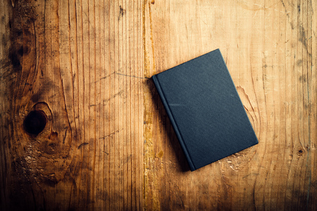work book: Black notebook on wooden office desk, top view