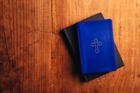 theology: Holy Bible on old wooden church table, top view