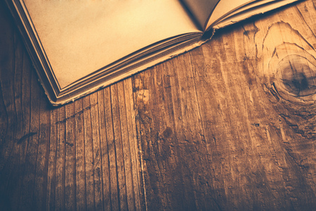 Old book wooden library desk, retro toned image, selective focus Foto de archivo