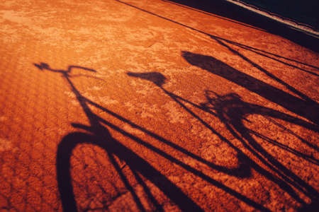 red clay: Vintage bicycle shadow on red clay ground Stock Photo
