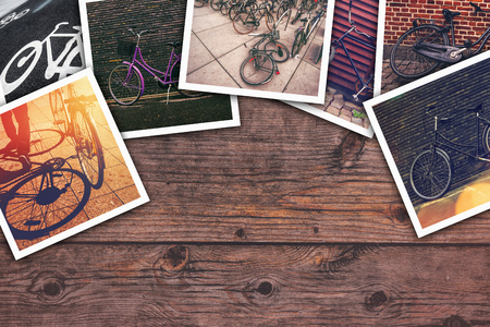 Bicycle pictures collage, stack of bike photos on wooden desk as copy space for cyclist lifestyle themed image.