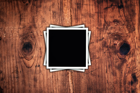 black boards: Blank square format photos on rustic wooden desk as copy space Stock Photo