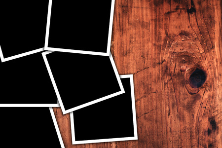 collage: Blank square format photos on rustic wooden desk as copy space Stock Photo