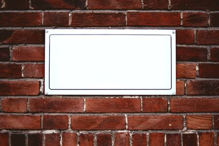 street name sign: Blank street name board on brick wall as copy space