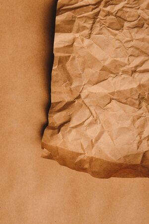 craft material: Crumpled brown kraft paper texture as background Stock Photo