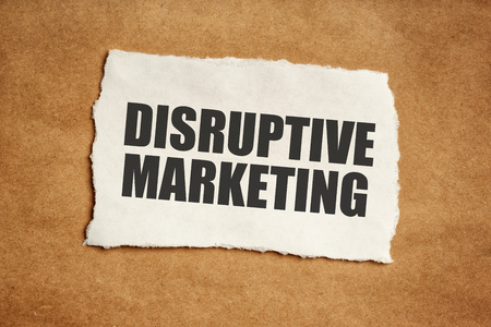 titles: Disruptive marketing concept, title printed on paper scrap.
