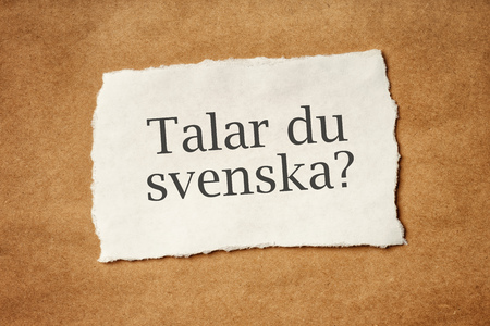 scrap paper: Talar du Svenska, Do you speak Swedish, question printed on piece of scrap paper, language school concept.