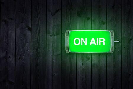 illuminated: On Air sign, green illuminated radio station signage.