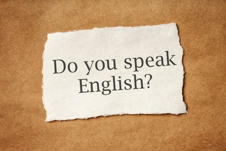 scrap paper: Do you speak english, question printed on piece of scrap paper, language school concept.