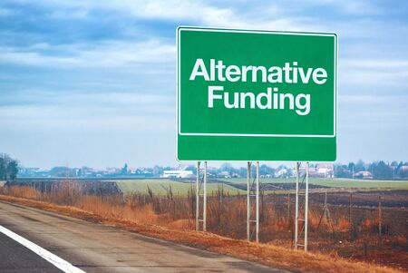 forthcoming: Alternative funding on road sign, entrepreneurship and business concept with road sign by the highway Stock Photo