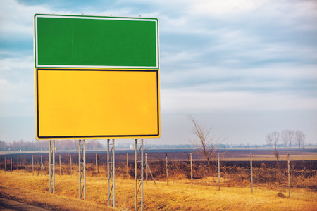 tollway: Blank traffic road sign by the roadway, copy space for text, retro toned. Stock Photo