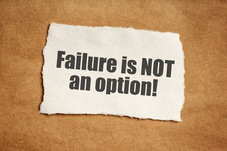 Failure is not an option motivational message on piece of scrap paper Stock Photo