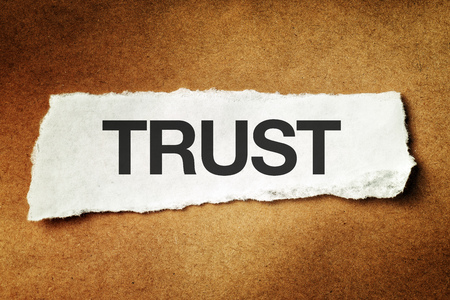 scrap paper: Trust printed on scrap paper, concept of faith, confidence and trustworthy. Stock Photo