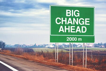 forthcoming: Big change ahead conceptual motivational image with road sign by the highway, retro toned image with selective focus Stock Photo
