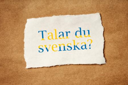 Talar du Svenska, Do you speak Swedish, question printed on piece of scrap paper, language school concept.